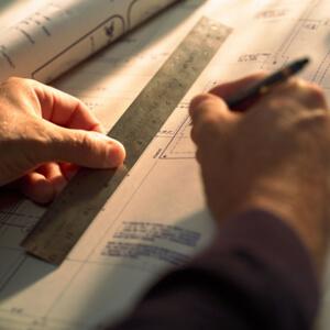 Architect Drafting Blueprint
